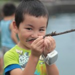 Enjoying touching insects in Nagasaki.