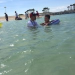 "Splashing at ""Emerald Beach"""